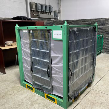 Steel rack with rows of compartment bags.